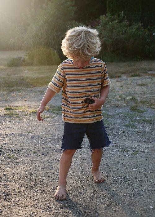 striped shirt boy on dirt