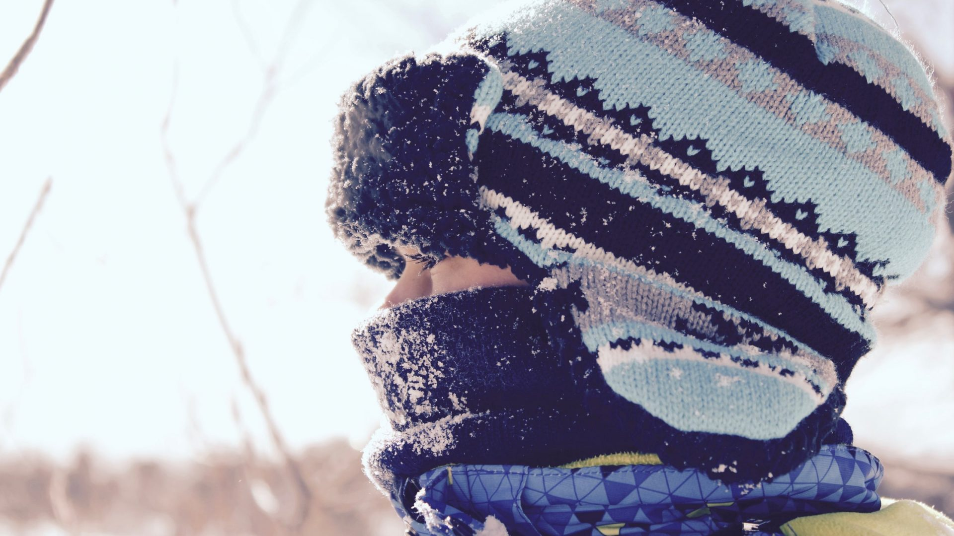 profile of child outside in winter
